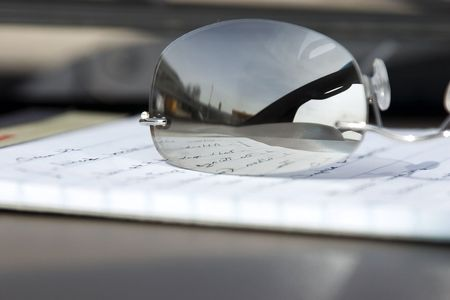 Glasses and the Notepad - Close Up photo