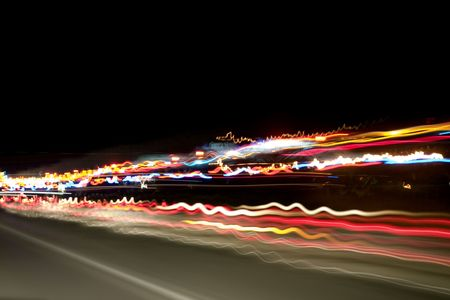 Shot of the highway and car lights taken from the car with a tripod while travelling. Stock Photo