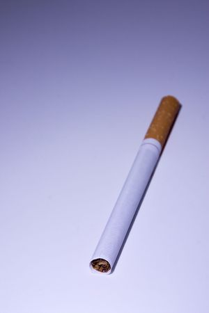 Isolated Unsmoked Cigarette Under Blue Light photo