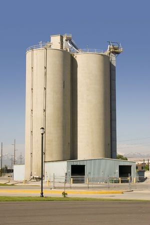 Silo with Clear Skies and Storage Barn in the Front Stock Photo - 415897