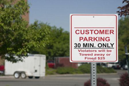 parking violation: 30 Minutes only Customer Parking Sign