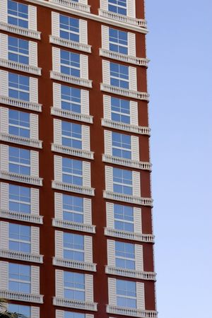 Close up on a Hotel Building with Windows Reflecting the Blue Skies