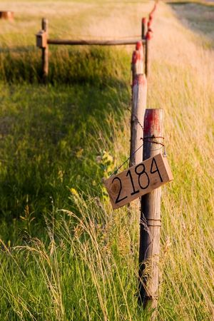 dilsiz: Wooden Fence by the Countryside with the street number sign