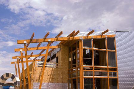 steelwork: Wooden Restaurant Patio Roof Construction Site