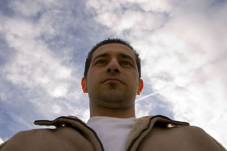 Man Looking up with the Clouds and the Blue Skies on the Background Stock Photo - 631874