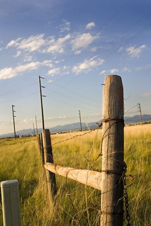 Wooden Fence and the Field with Electric Poles in Helena Montana Stock Photo - 631778
