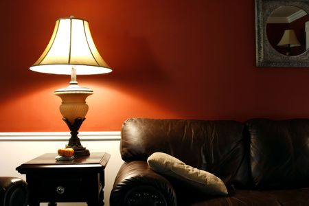 Close up on a Lamp and the Coush in a House photo