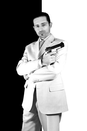 Isolated Mafia with arms crossed and a gunon hand Stock Photo
