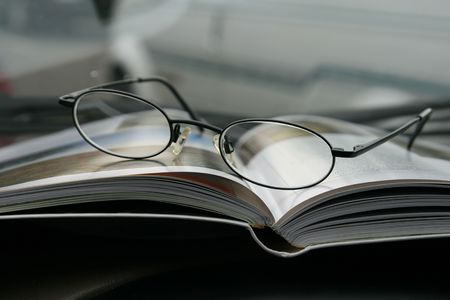 Glasses and the Magazine - Close Up photo