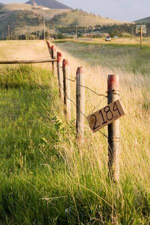 Fence on with the Property Sign Stock Photo