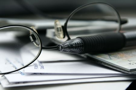 Close up on the Glasses and the Checkbook