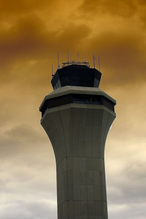Air Traffic Control Tower with Clouds on the Background