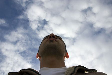 sarcastic: Man Looking up with the Clouds and the Blue Skies on the Background