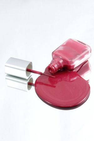 nail polish bottle: Isolated Nail Polish Spilling on a Mirror with the Brush