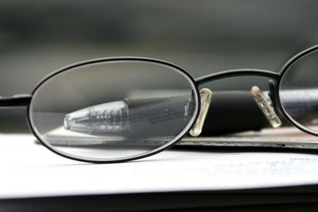Close up on the Glasses and the Checkbook photo