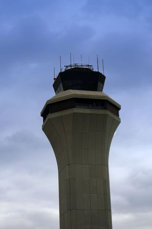 airborne vehicle: Air Traffic Control Tower with Clouds on the Background