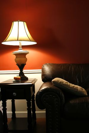 night table: Close up on a Lamp and the Coush in a House