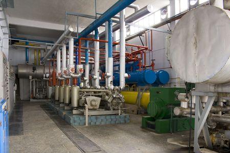 alternator: Industrial size generators in a factory machinery room