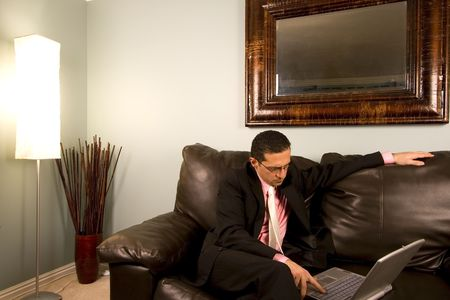 design office: Home or Office - Businessman with his Glasses working on the Couch