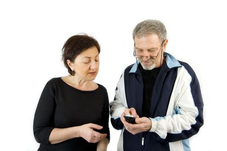 Couple checking the Text Message on a Wireless Phone photo