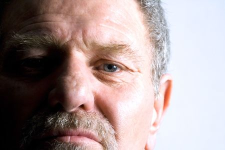Isolated close up on the face of an elder man Stock Photo - 2781395