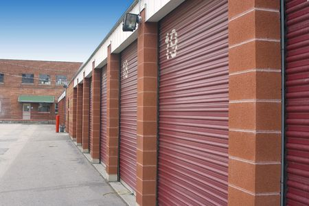 Numbered Storage Unit Doors and its parking lot Stock Photo