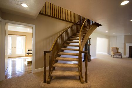 Living Room with Stairs going up in a house photo