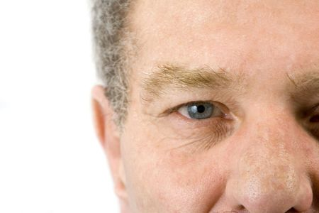 Isolated close up on the face of an elder man Stock Photo - 3010810