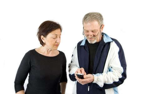 Husband on the Phone checking an incoming text message while wife looking over his shoulder- Isolated photo