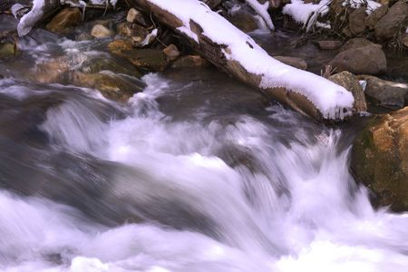 Flowing water in River with Snow on a branch Stock Photo - 3412795