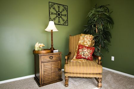 Close up on a corner of a house with a chair and nightstand Stock Photo