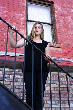 Beautiful Girl in Black dress posing outdoors in the City - Urban  photo