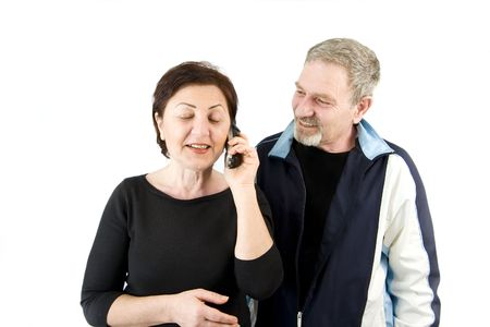 Wife on the Phone while Husband Waiting for the News - Isolated photo