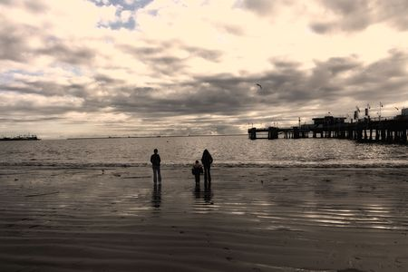 Family Walking on Long Beach, California in a Cloudy Day photo