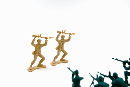 Isolated Plastic Toy Soldiers - Surrender photo