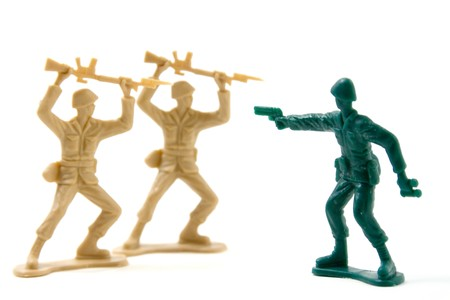 Isolated Plastic Toy Soldiers - Courage Concept photo