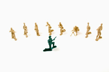 Isolated Plastic Toy Soldiers - Stubborn Concept photo