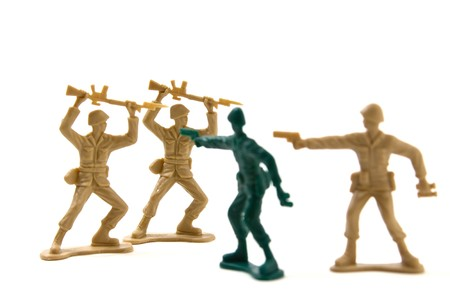 Isolated Plastic Toy Soldiers - Courage Concept by Prematurely Surrendering Soldiers photo