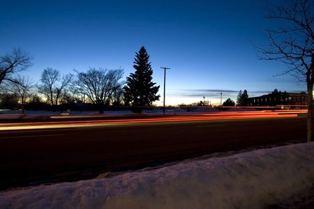 Night Shot of a Street in Winter Time with Snow on the Ground photo