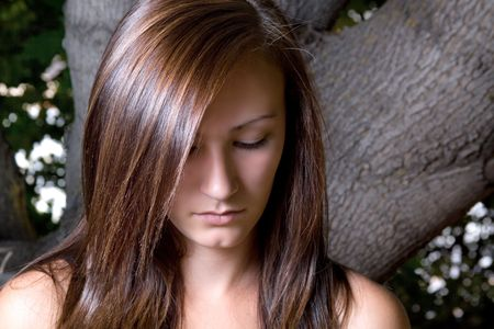 Close up on a Beautiful Depressed Teenager Posing photo