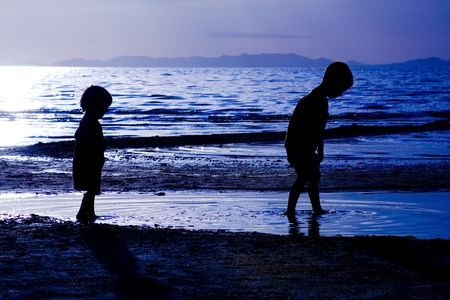 Kids playing on the beach - silhouette shot Stock Photo - 5789099