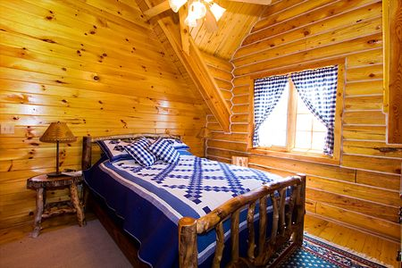 vintage furniture: Close up on a Bedroom in a Log Cabin