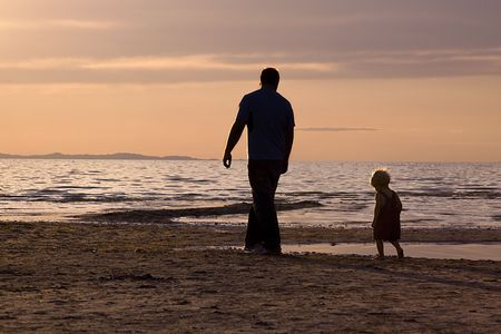 Father and Son on the Beach - Silhouette Shot photo