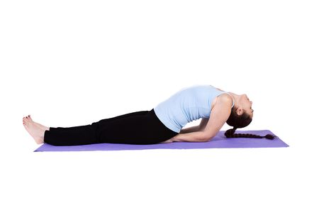 Woman in Yoga Position - Isolated Background Imagens