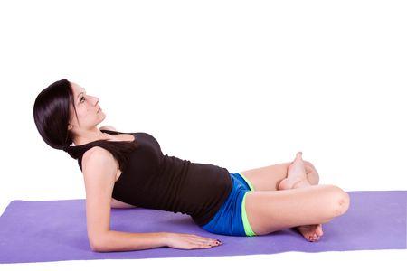 Teenager doing Yoga Imagens