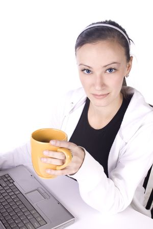 Smiling Teenager with a Cup of Coffee Working - Isolated Background photo