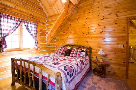 lodging: Close up on a Bedroom in a Log Cabin