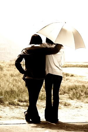 Teenage Girls Looking Out the Door with an Umbrella photo