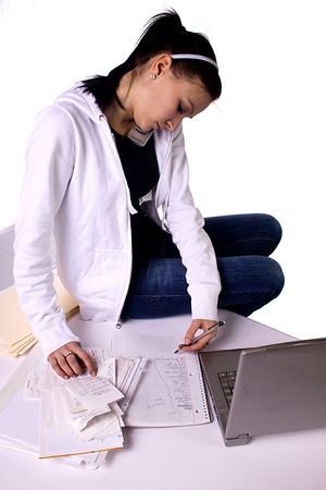 Teen Girl Paying Bills and Making a To Do List - Isolated photo