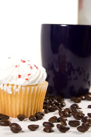 Isolated Coffee Mug with beans and cupcakes photo